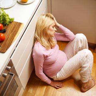 Foto de gestante com fadiga durante a gravidez